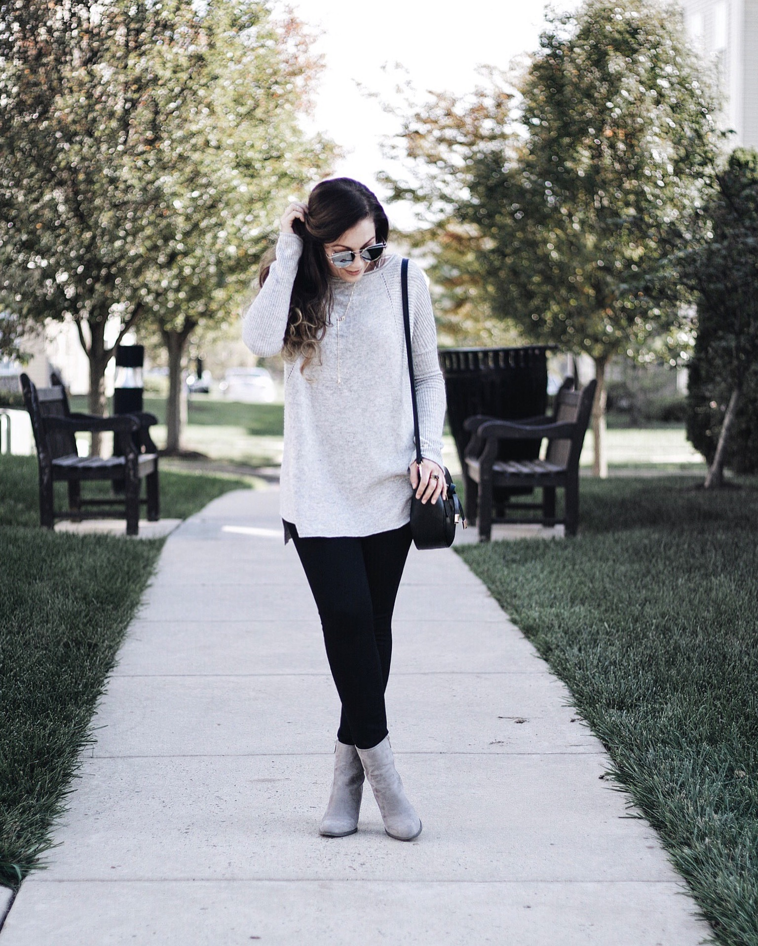 grey sweater and booties