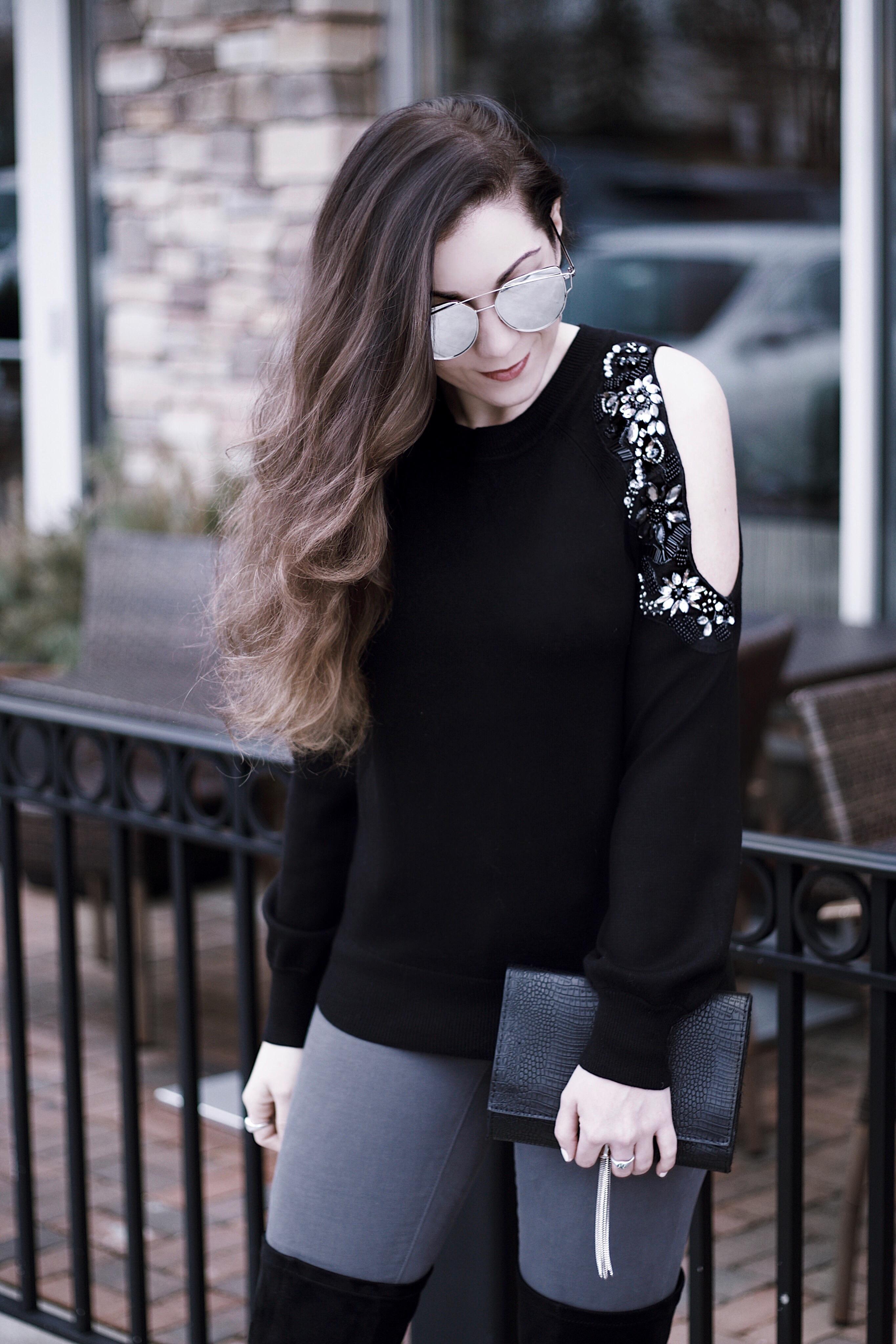 Black Embellished Cold Shoulder Sweater, Black OTK Boots, Grey Jeans, Black Croc Tassel Bag