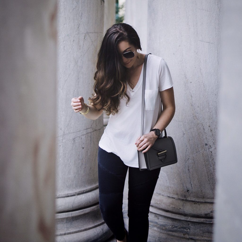 Model off duty, Greats brand slide-on sneakers, oversized tee, moto jeans, Camelia Roma bag