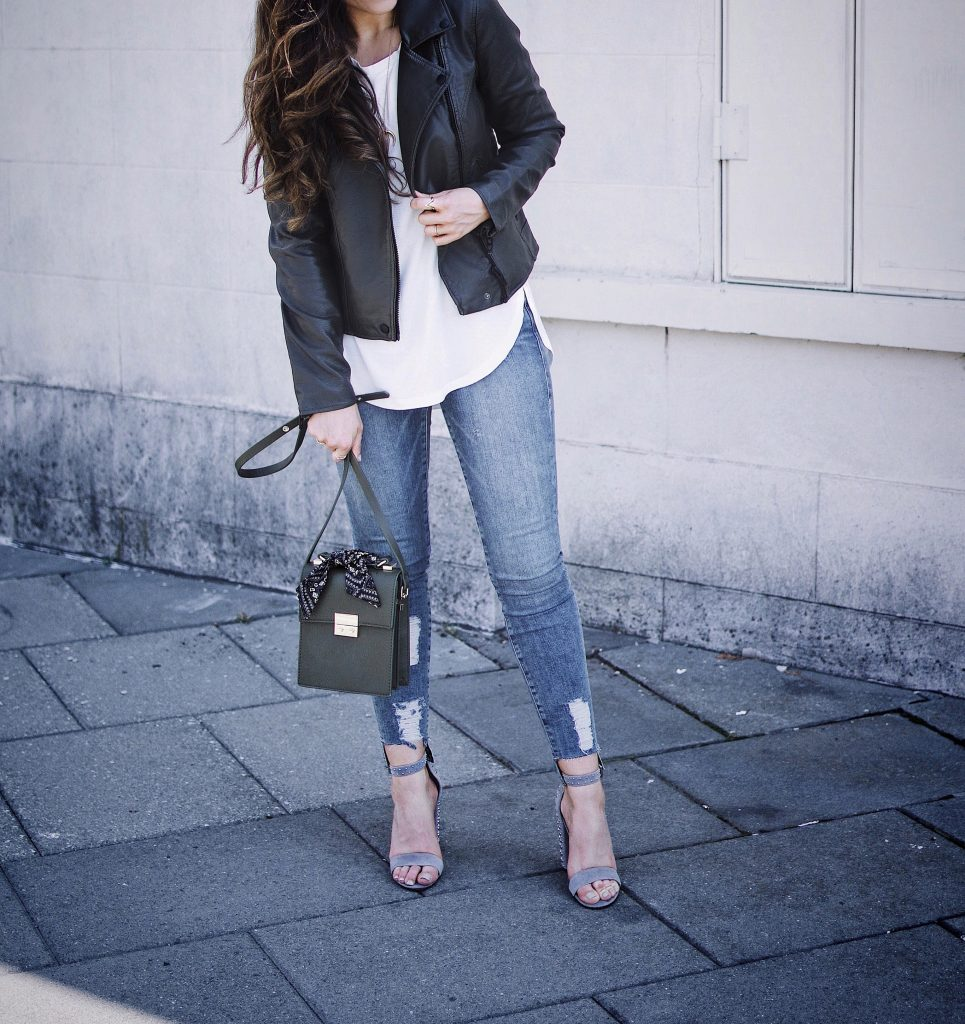 10 Travel Must-Haves, Olive Moto Jacket , Dolce Vita Studded Heels, Good American Jeans