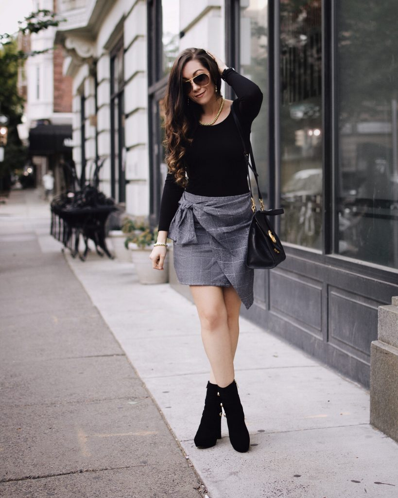 European Fall Look | Plaid Wrap Skirt, Michael Kors Military Boots, Black Scoopneck Top, Gucci Bag, Lagos Jewelry